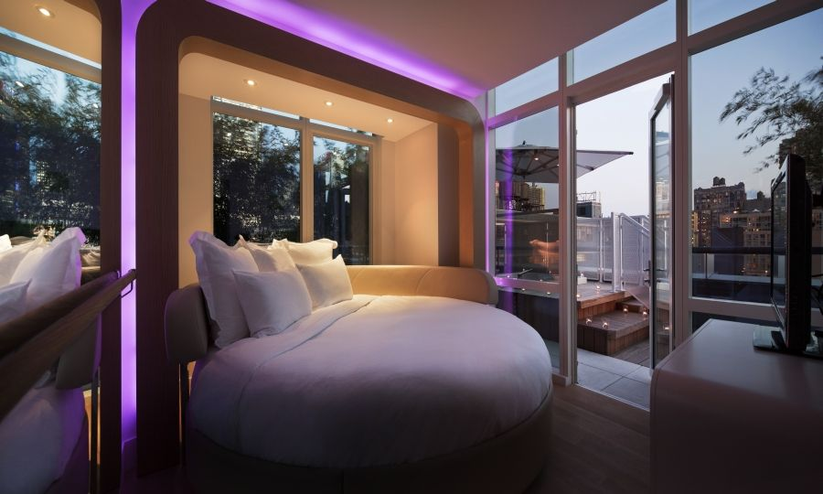 Round Bed And Purple Lights