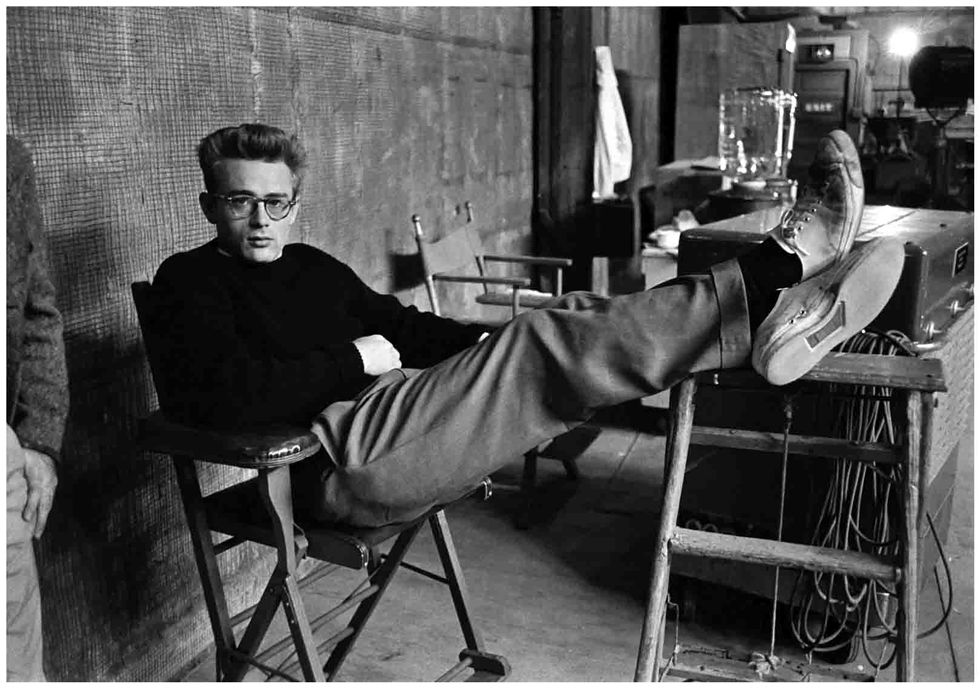 235a8d7a4fc4f4 James Dean kicks back in a black sweater