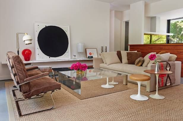 Various textures play off each other in the neutral living room. The mirrored coffee table and sofa were designed by Gresham's friend and colleague, Joe D'Urso.    - ELLEDecor.com