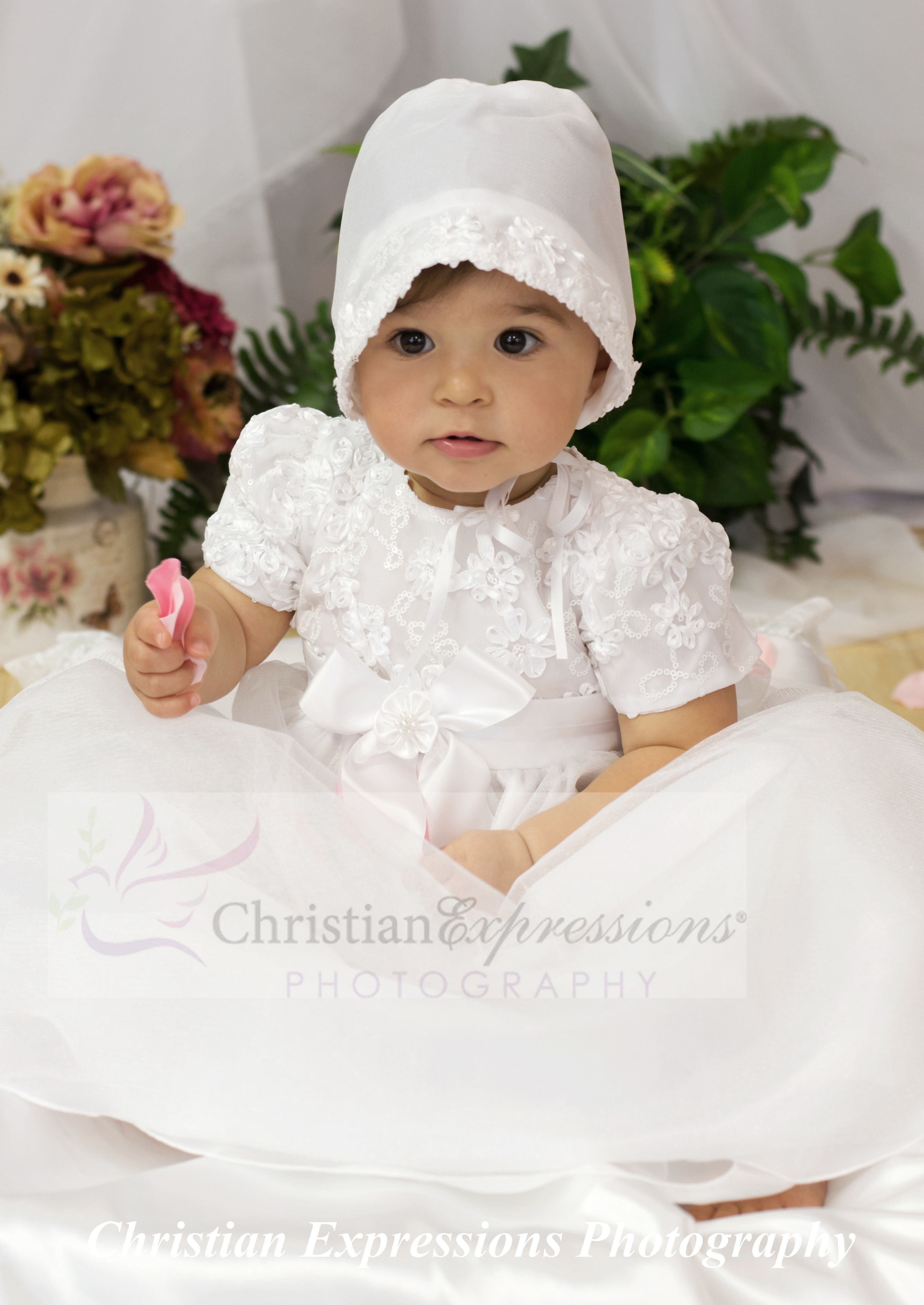 c6cc10d94 This adorable baby girl is getting her christening pictures taken at  Christian Expressions. The christening gown was purchased in our showroom  Christian ...