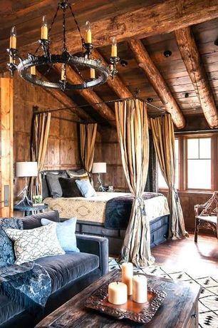 Rustic log cabin bedroom with a cozy canopy bed decoist