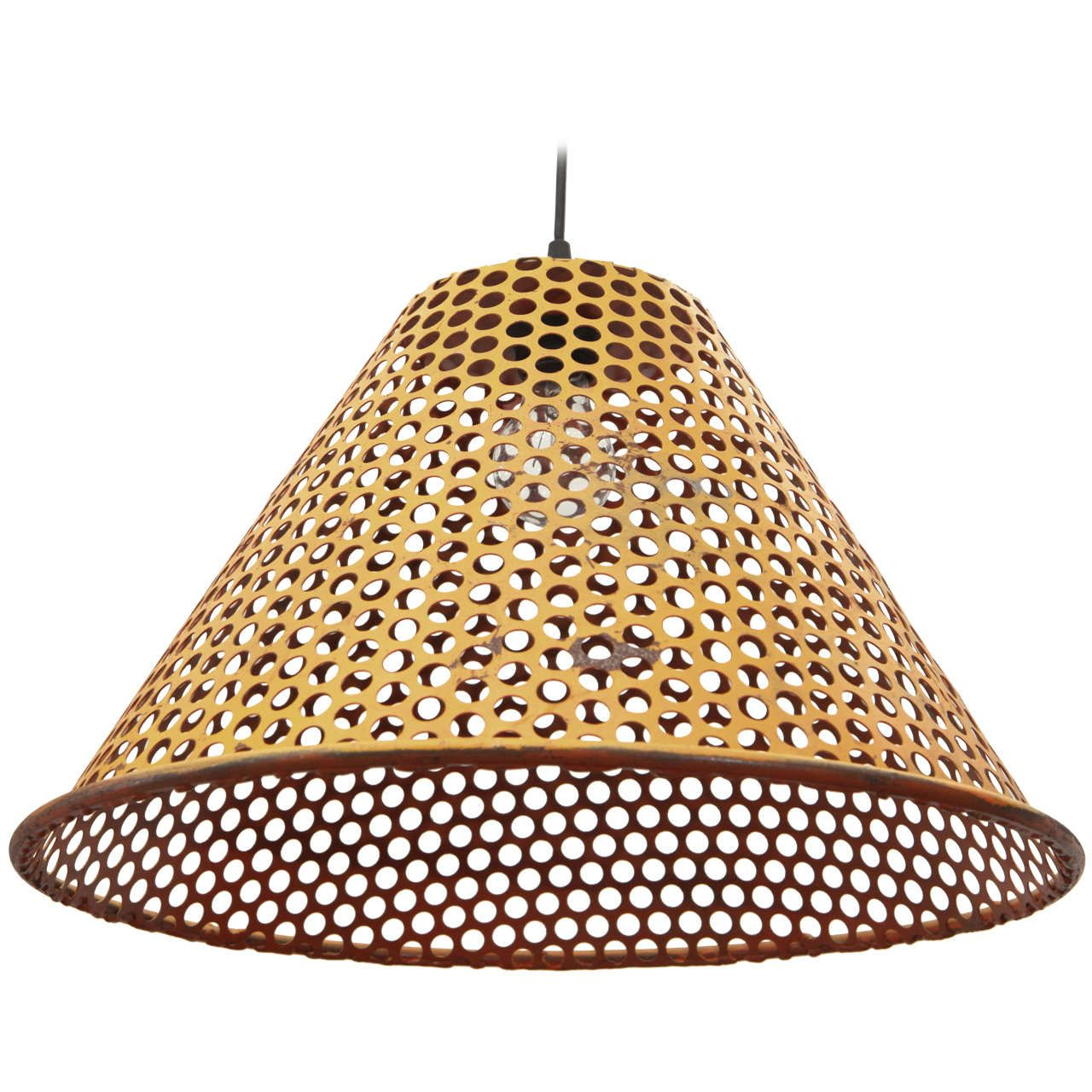Yellow metal perforated pendant pendant lighting metals and