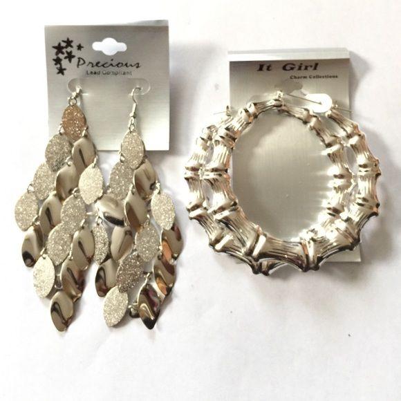 Silver tone earrings I'm selling a pair of silver tone dangle earrings and a pair of silver tone bamboo earrings Jewelry Earrings
