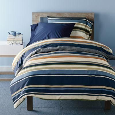 Striped duvet cover set. Mercer Stripe bedding set printed with bold variegated stripes in shades of sand, ivory, blue and rust. Twin and Twin XL bedding sets include one duvet cover and... More Details