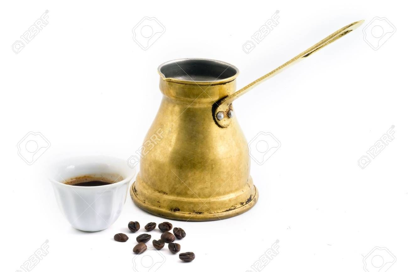Arab small copper coffee pot with cup and coffee beans