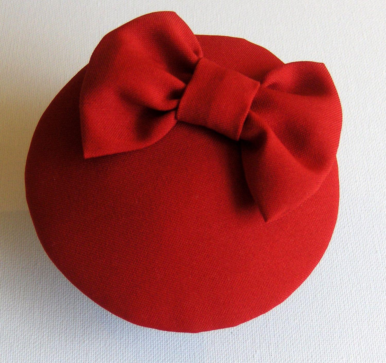 Miss Scarlet. Red Cocktail Hat.. £32.00, via Etsy.