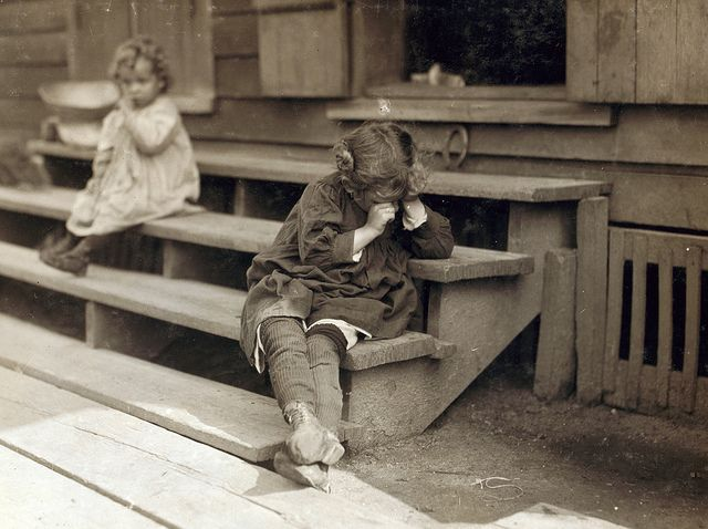 5 yr old after day's work that began at 5 AM, was tired and refused to be photographed, the mother said, 'Oh, She's ugly,' said picking shrimp was very hard on the fingers, Biloxi, MS, by Lewis Wickes Hine 1911  –– Teabagger Right Wing NeoLiberal good ole days.
