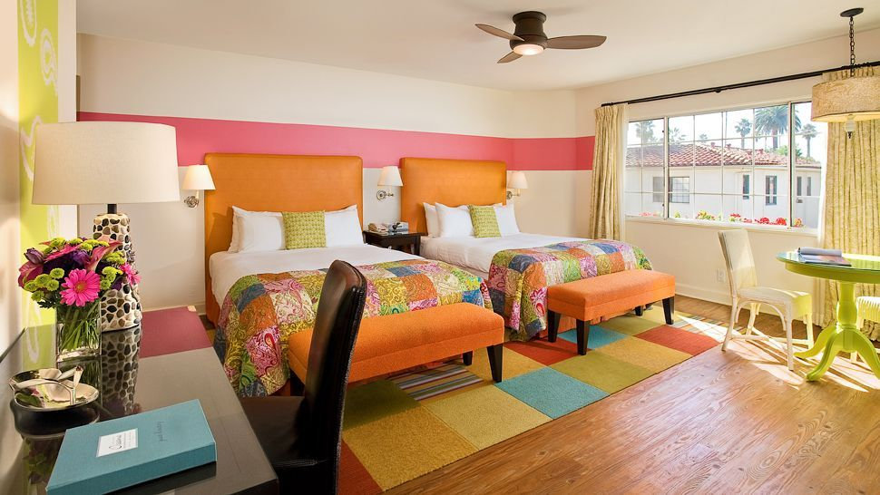 This Room Uses Split Complementary In Its Shades Of Yellow Orange Red Orange And Blue The Room Is Bright And Fun Be With Images Santa Barbara Hotels Santa Barbara Hotel