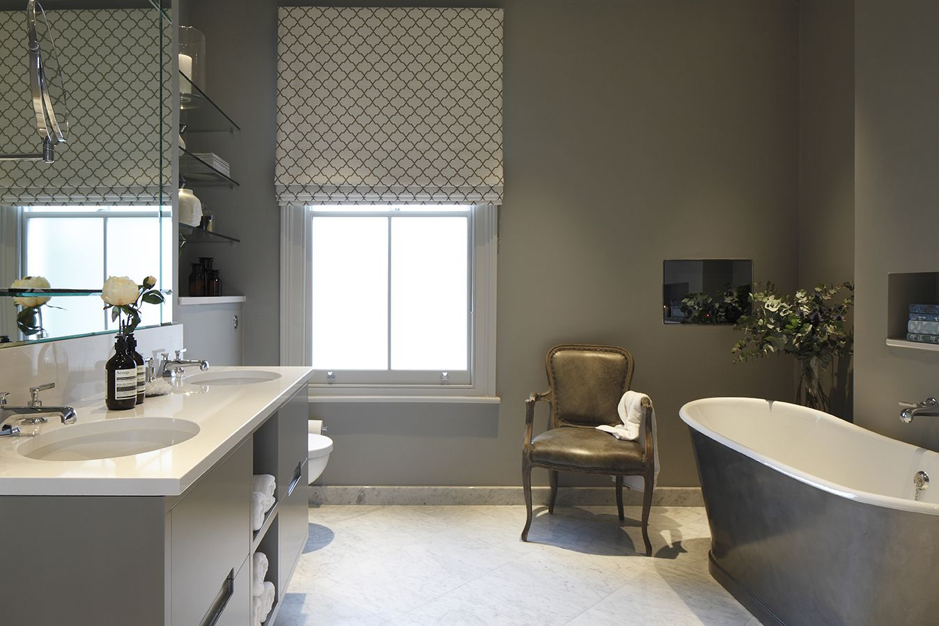 Master bedroom ensuite design  Lovely grey background featuring a small tub Designed by Laura Get