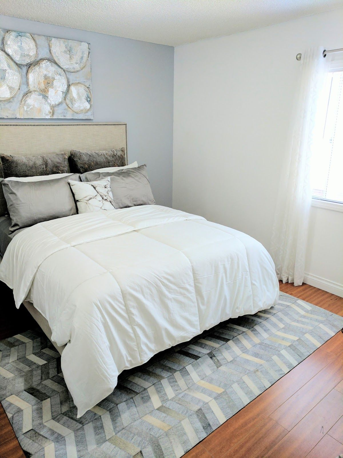 Master bedroom refresh with Rugs USA s Mandovi Cowhide AL01 Rug