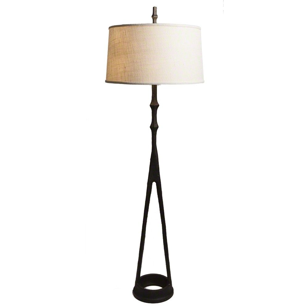 Giacometti-style floor lamp is made of cast aluminum in an antique ...