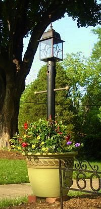 How To Make A Light Post Planter For Your Yard Today S Homeowner Post Lights Outdoor Lamp Posts Yard Lights
