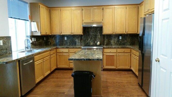 Golden oak cabinets with aj brown granite, u shaped ...