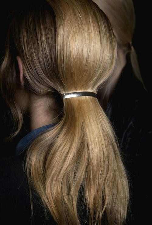Hair with simple barrette.