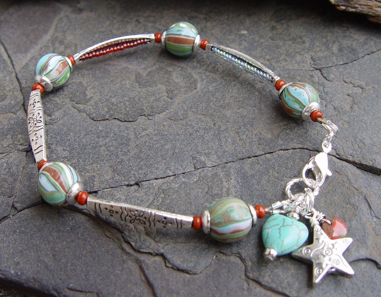 Art Beads, Bali Style Silver, Turquoise Magnesite Heart and Silver Star Southwest Bracelet Boho Gypsy. $39.50, via Etsy.