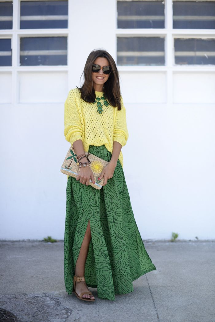 Yellow oversized sweater, green bauble, green printed maxi, tan sandals and embroidered straw clutch