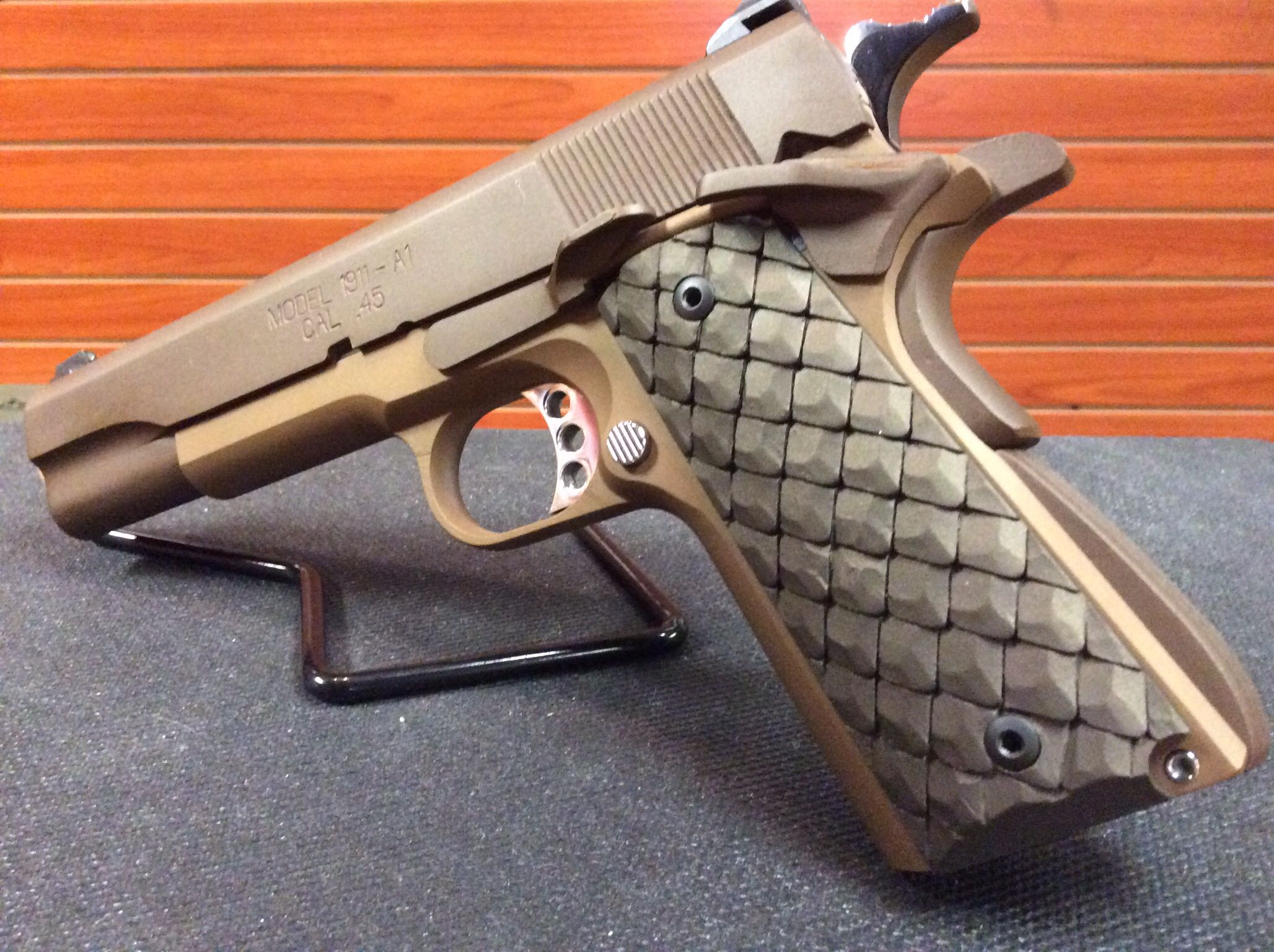 cerakoted 1911 with dragon scale grips