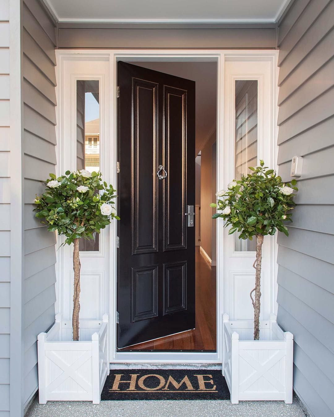 Welcome home to this classic hamptons style front entrance for Front entrance home designs