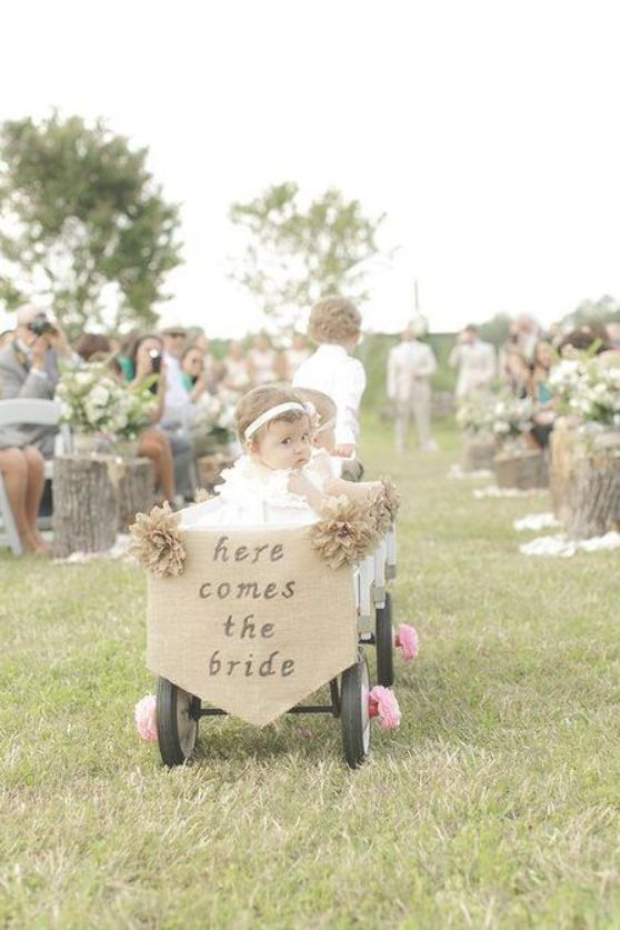 For any wedding party participants too young to walk down the aisle enlist the help of the ring bearer to pull them in a rustic wagon