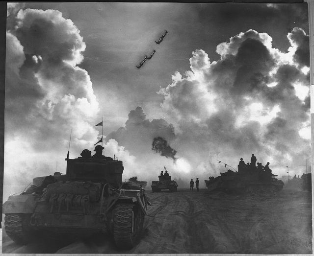 A British 25 pounder gun takes part in the night barrage