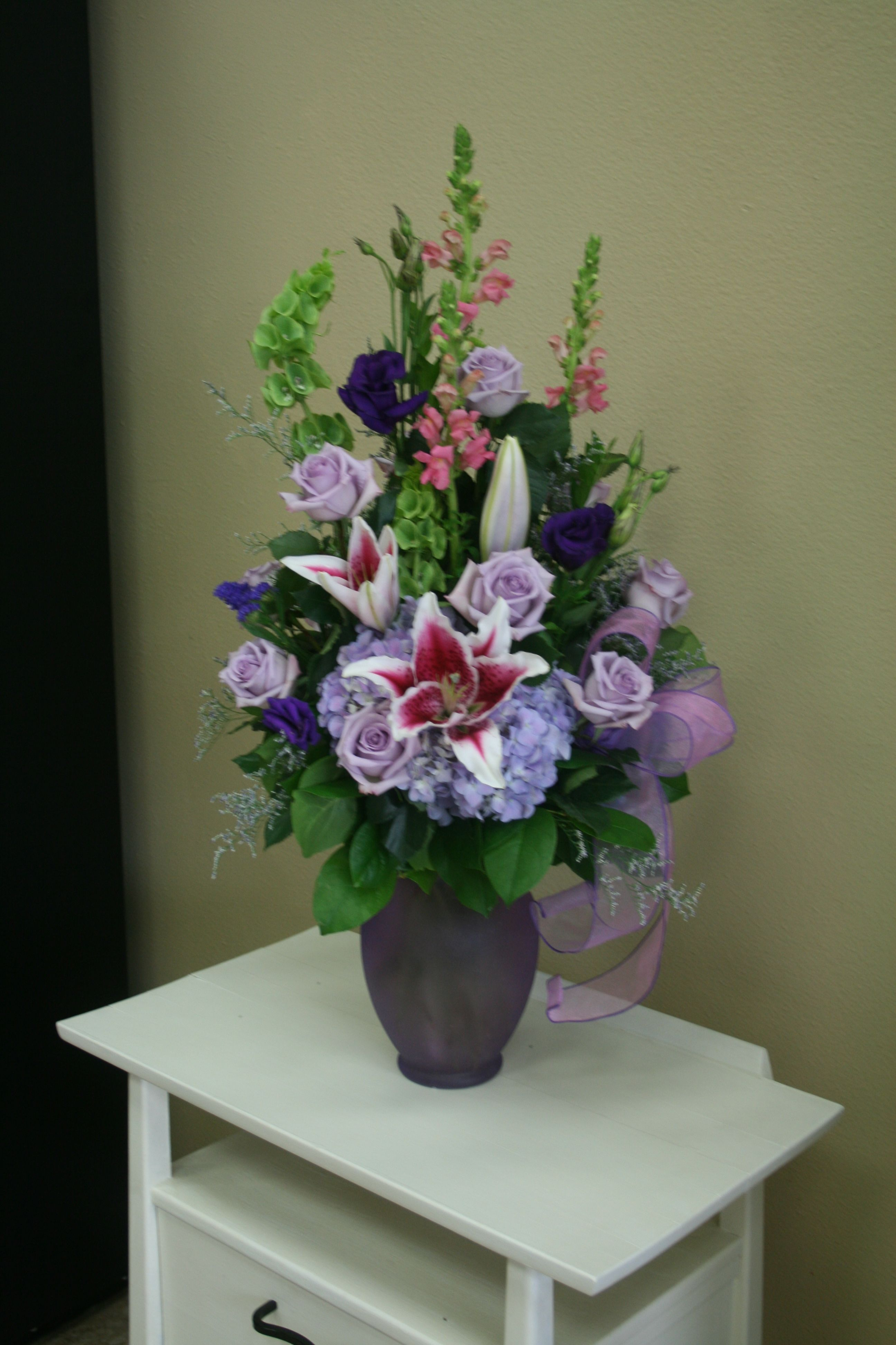 Purple And Pink Flower Arrangement With Purple Roses Pink Lilies