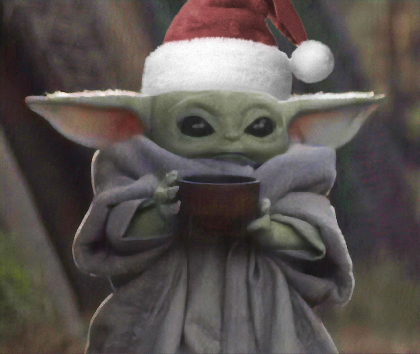 Baby Yoda ready for some nonalcoholic Christmas punch