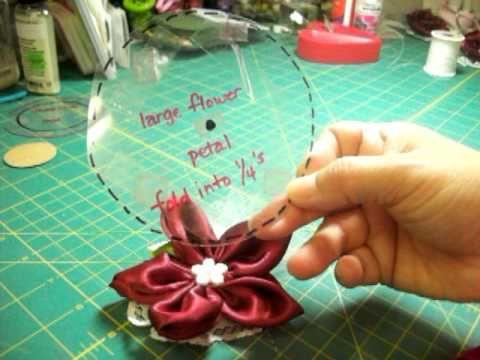 5 petal fabric flower tut  http://www.youtube.com/watch?v=EjtXI4l1cU4