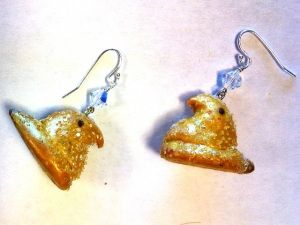 Peep earrings made with polymer clay.
