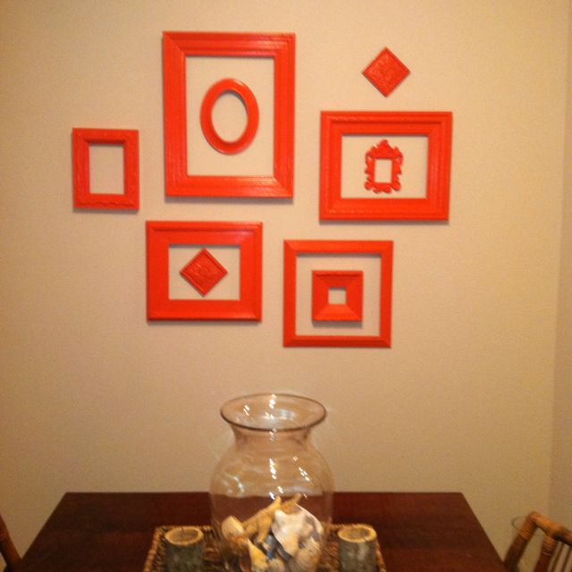 My new wall!!!! Repainted these frames and clustered them on the wall in my entry/dining area
