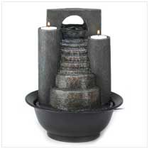 Fire and water combine to form one spectacular decoration! Cascades of water trickle down faux-stone steps, while tealights glimmer from atop twin pillars. A #tabletop #fountain to treasure!  #tabletopfountain