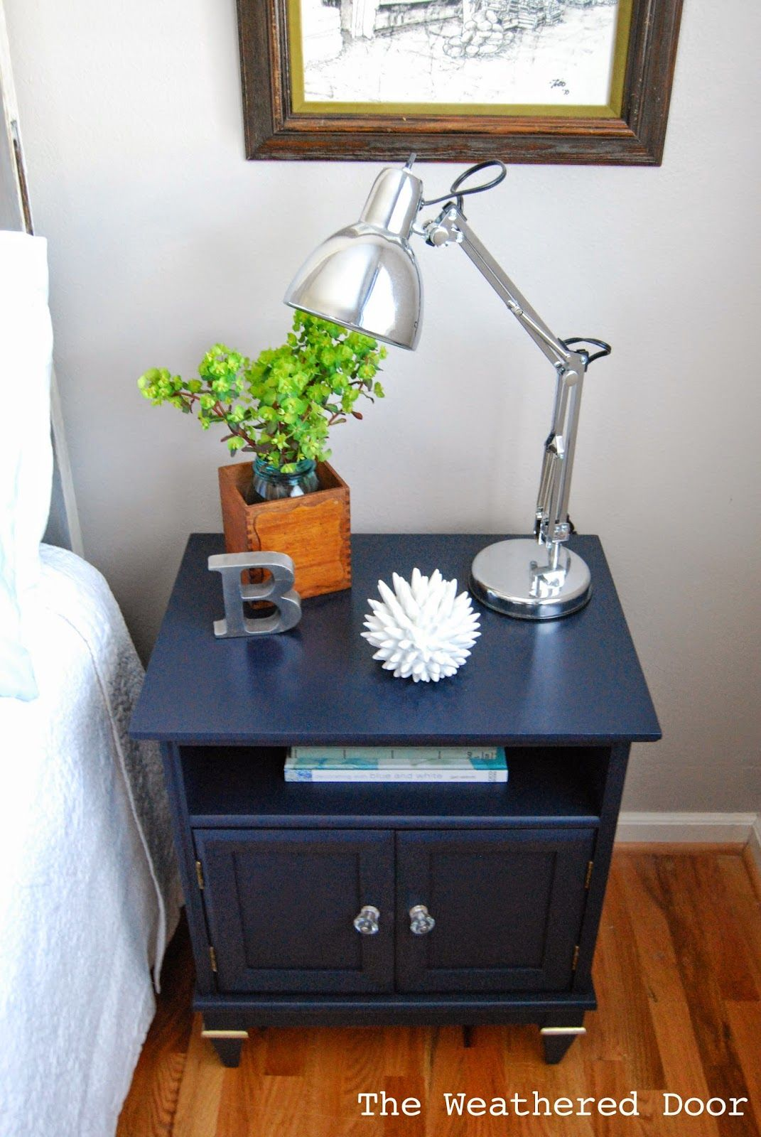 A Navy Nightstand with Papered Doors Nightstand