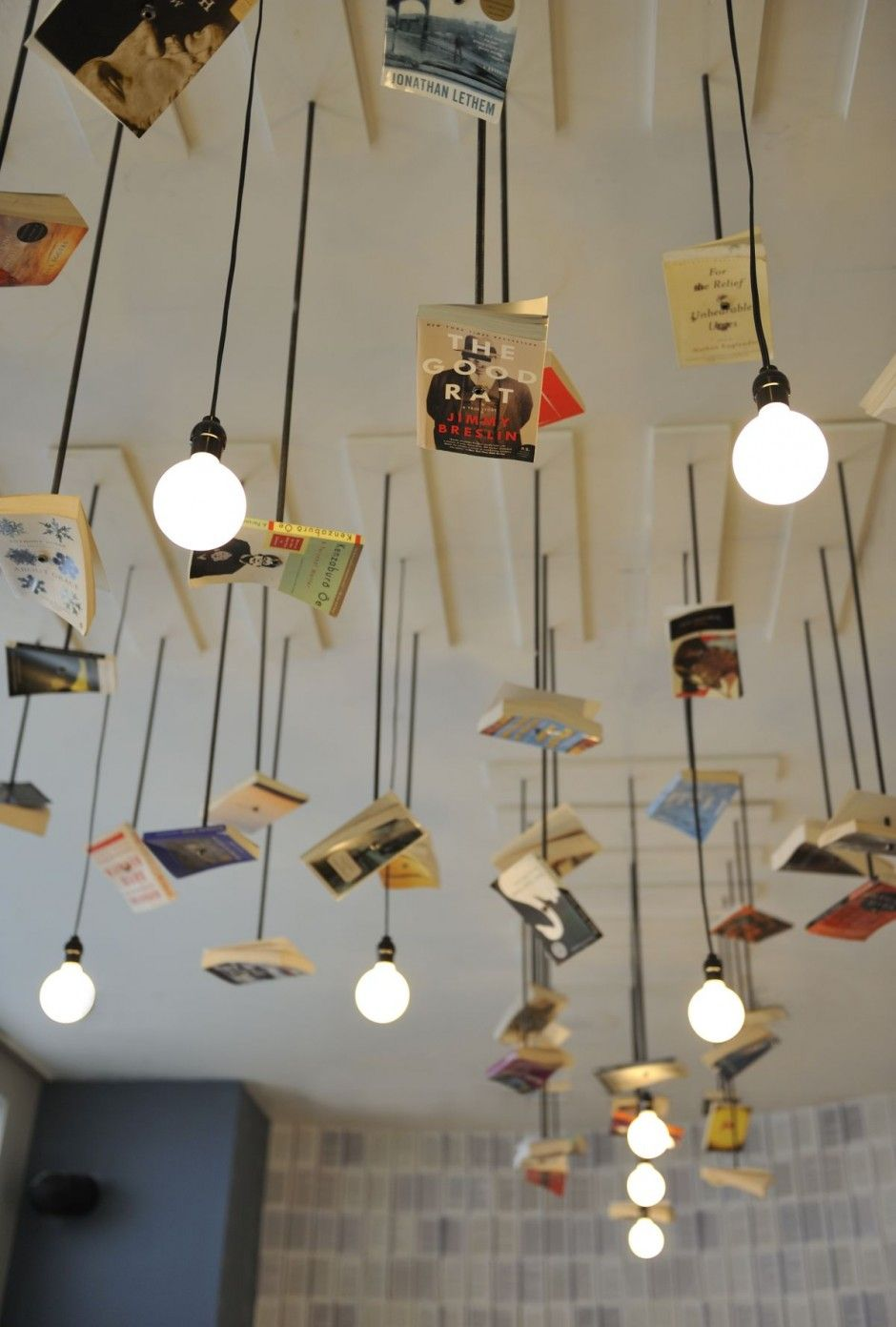 lighting mcnally jackson cafe lighting design with hanging scattering of books
