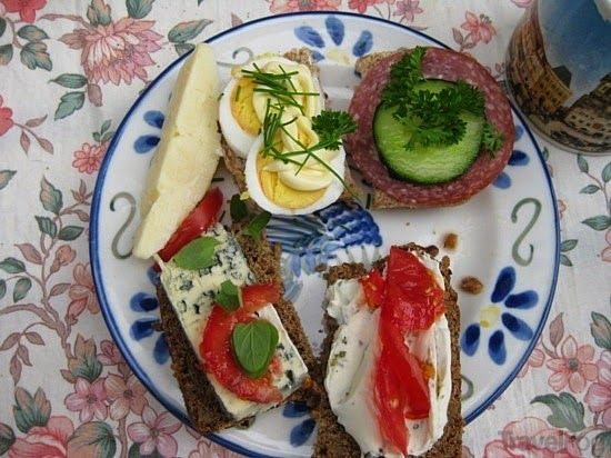 NORWEGIAN BREAKFAST FROKOST Open sandwiches: meat cuts, cheese, spread, jam, cereals. Milk, juise, coffee, tea.
