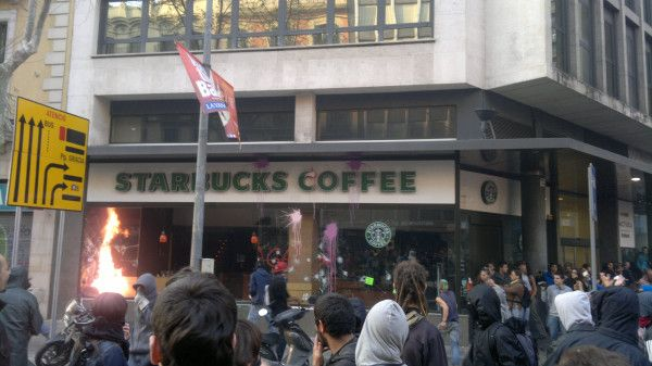 A Starbucks is set alight in a Barcelona protest for labour reform.
