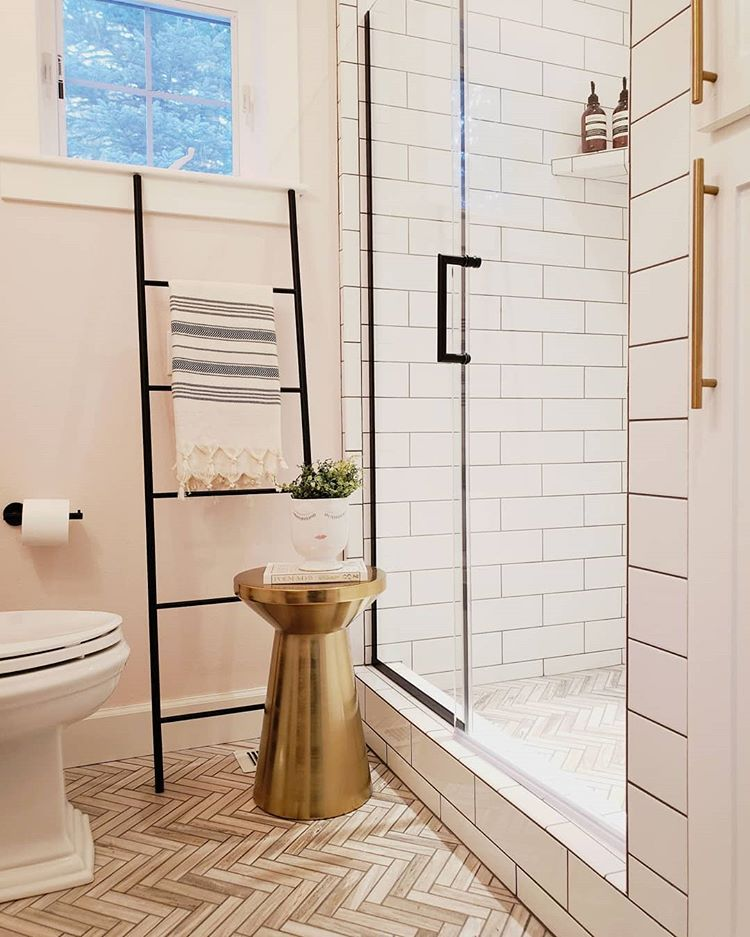 This Bathroom Is Tiny We Updated It With White Subway Tile Marble Herringbone Tile And Matte Black Fixture Bathroom Redo Tiny Bathroom Tiny Bathroom Storage