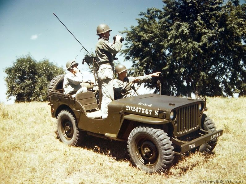A Gi In The Back Seat Of A Jeep Sends A Telephone Message During