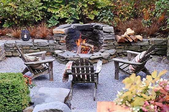 Photo of A cozy, sunken seating area becomes prime real estate for a fire pit. This fire …