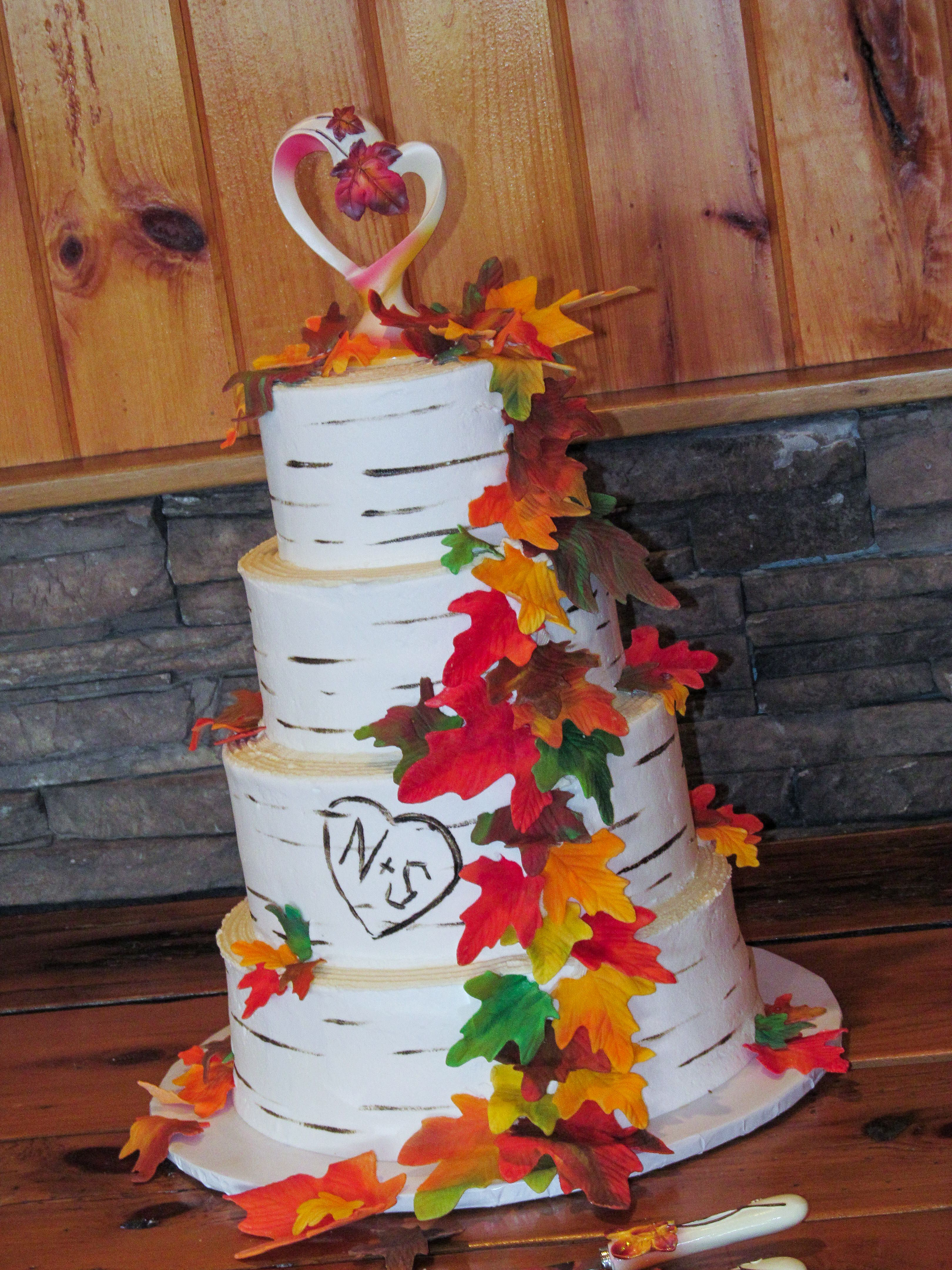 A 4 tier fall themed wedding cake. Buttercream icing ...