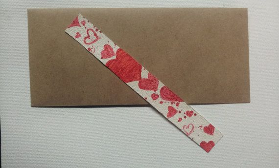 This seems like a pretty cool idea.   Customizable Valentine's Day GIft Bookmark by ByKittyMcCormick, $10.00