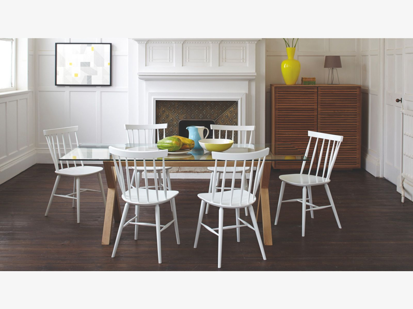 A Contemporary Update On The Traditional Spindle Back Chair Striking Talia White Dining Works Well With Variety Of Table Designs