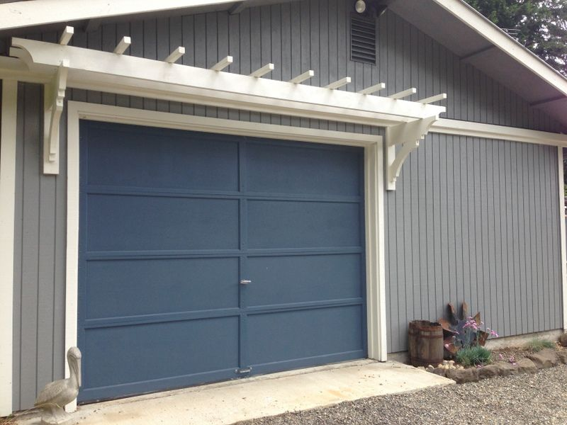 diy garage doorblue roof cabin DIY Trellis Over the Garage Door  Garden