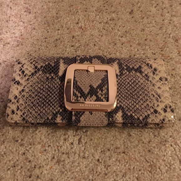Michael Kors python clutch 100% authentic MK, used only 3 times. Interior is perfect, just some scratches on the gold buckle. Pls see detailed pics thus price is reflected. Beautiful and sophisticated snakeskin evening clutch that goes with just about anything! No low ball offers. Comes with original dust bag Michael Kors Bags Clutches & Wristlets
