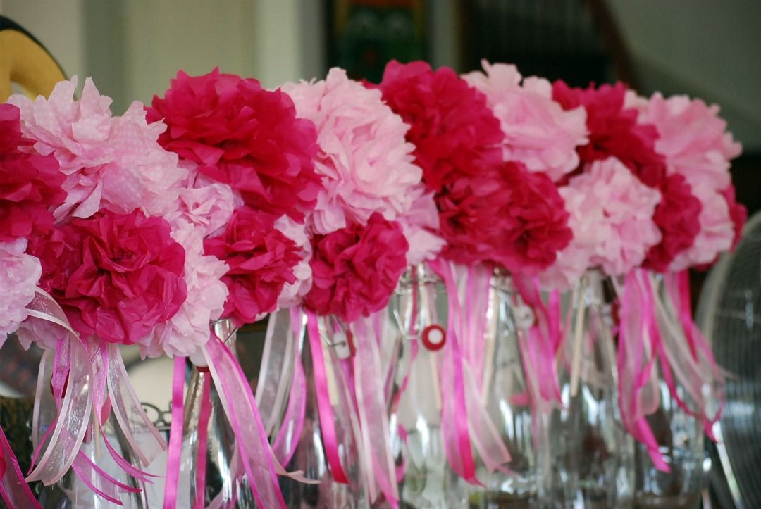 Table Centerpieces Madeof Tissue Paper Pompoms Made Into A Bouquet Held By A Chopstick And Placed In Water Bottles Paper Flowers Paper Pom Pom Garland Decor
