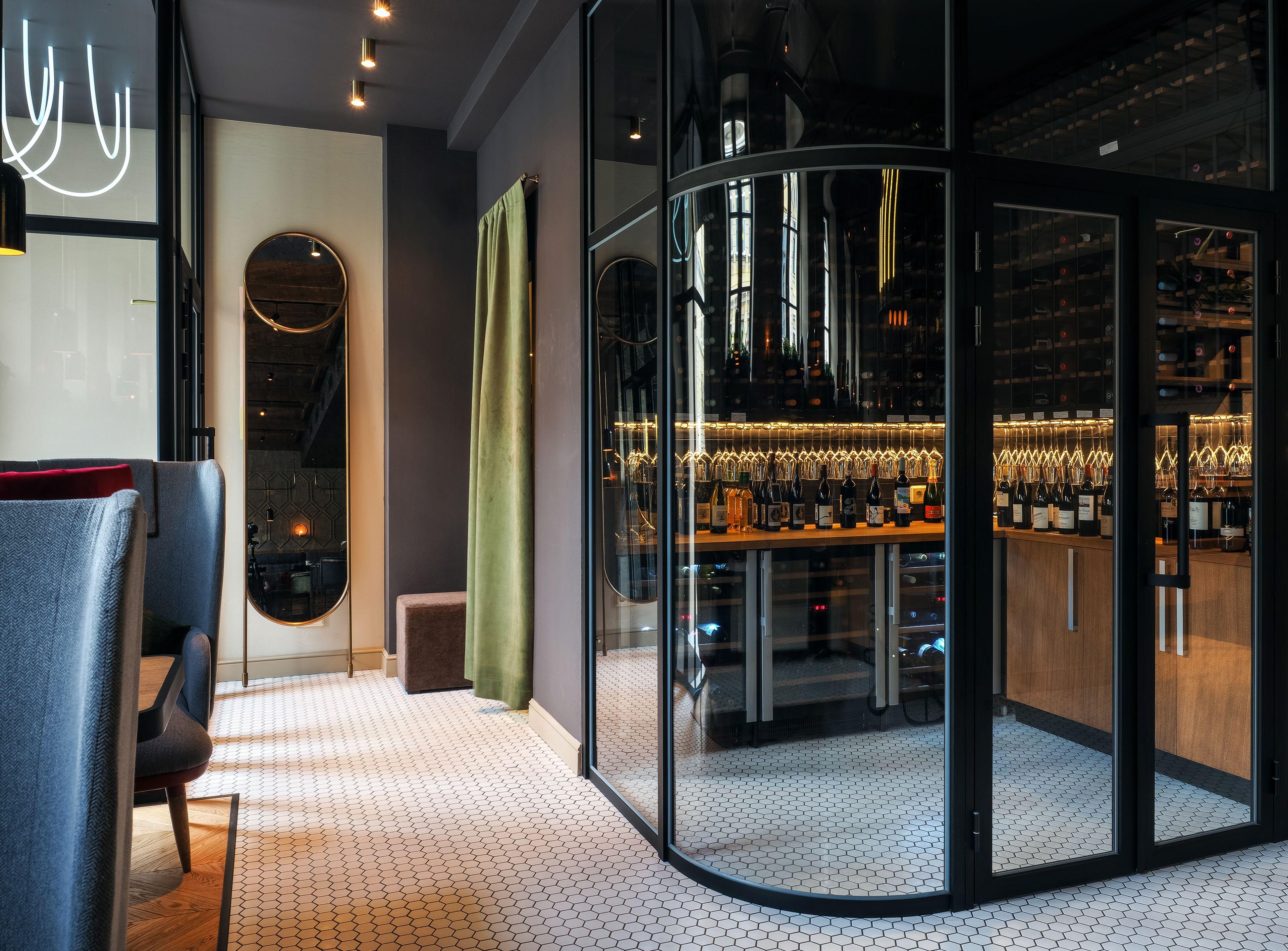 Greneta wine bar wine cellar within curved glass walls oba by bao