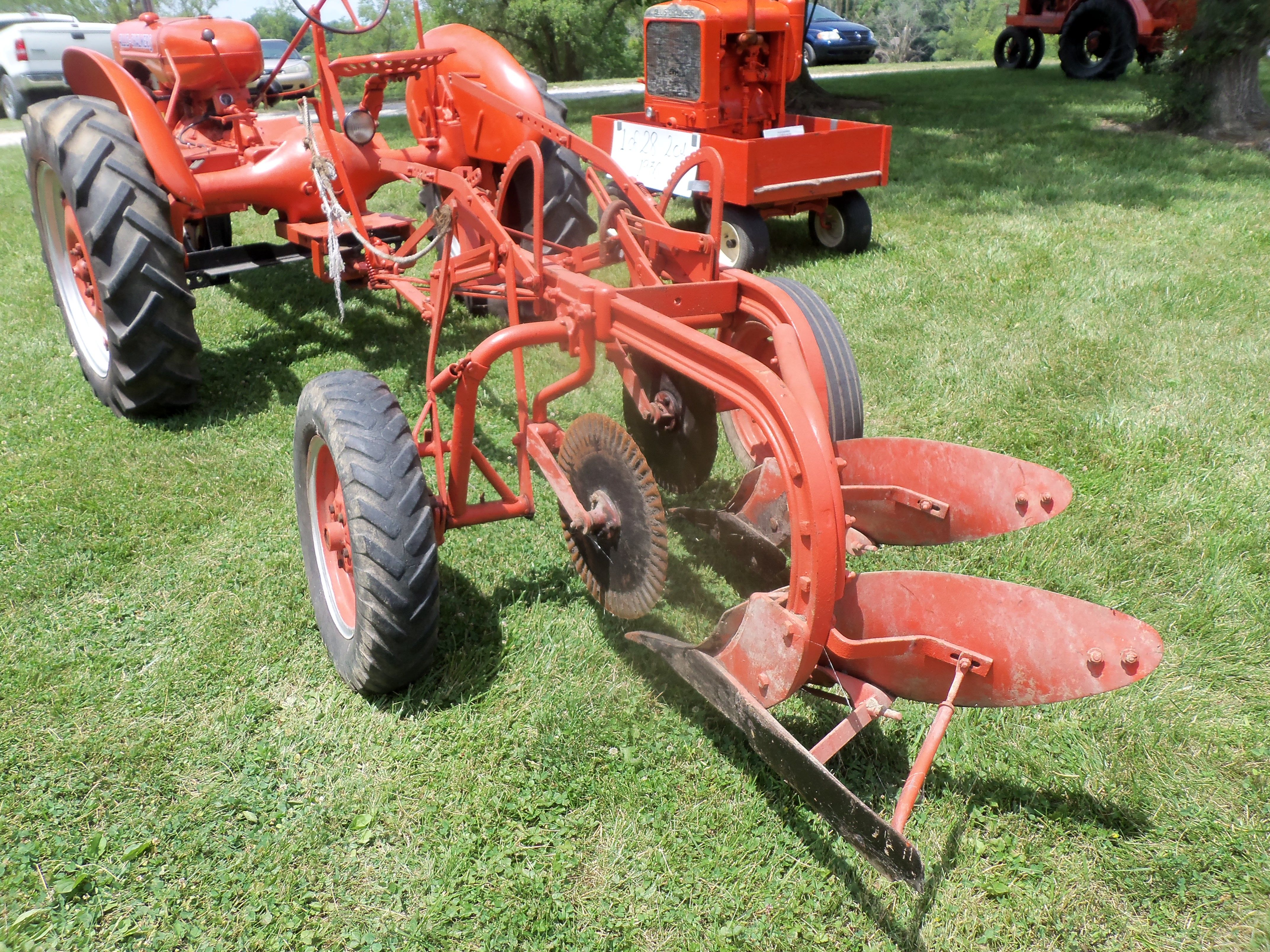 2 bottom plow hooked to Allis Chalmers RC