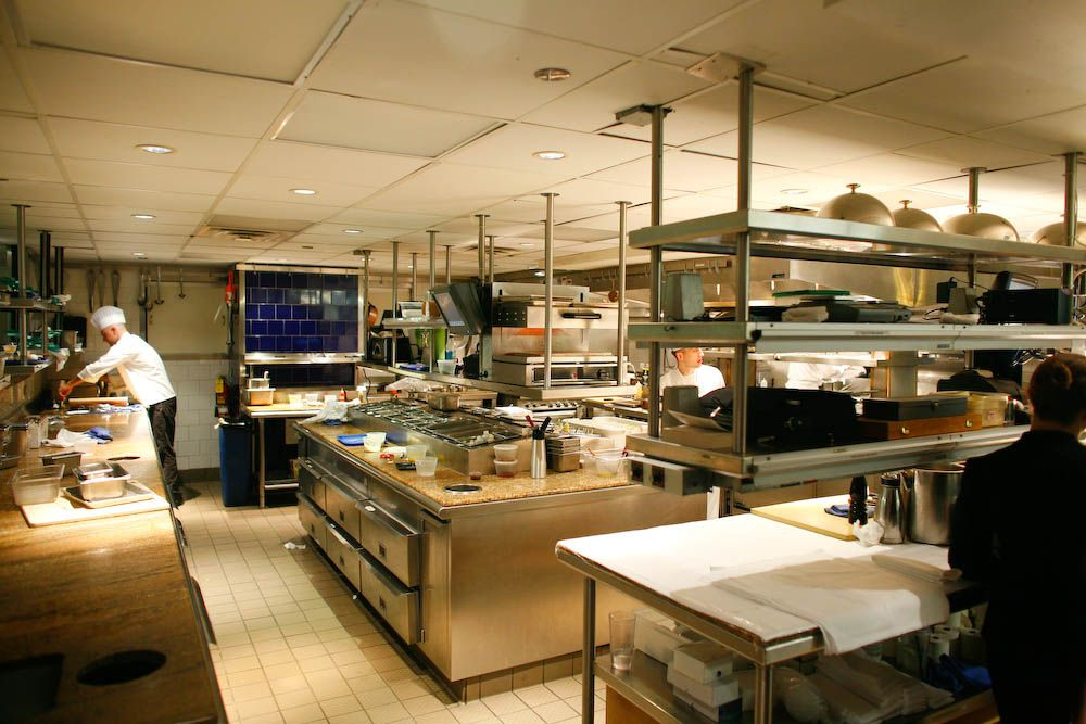 Best Restaurant Kitchen loving the ceiling mounted storage | x design - restaurant