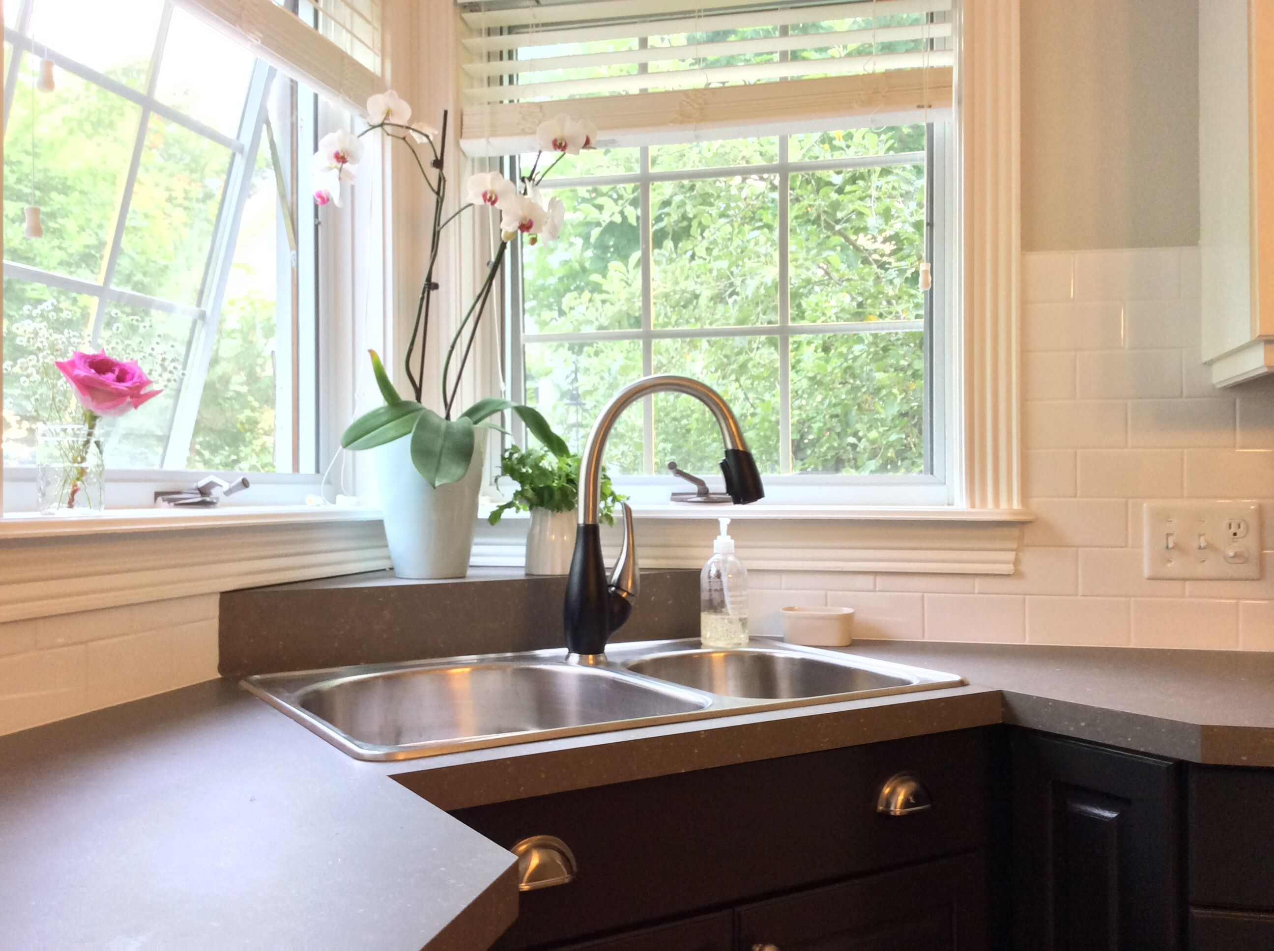 Corner window kitchen sink  corner sink featuring gooseneck pull out delta faucet and pretty