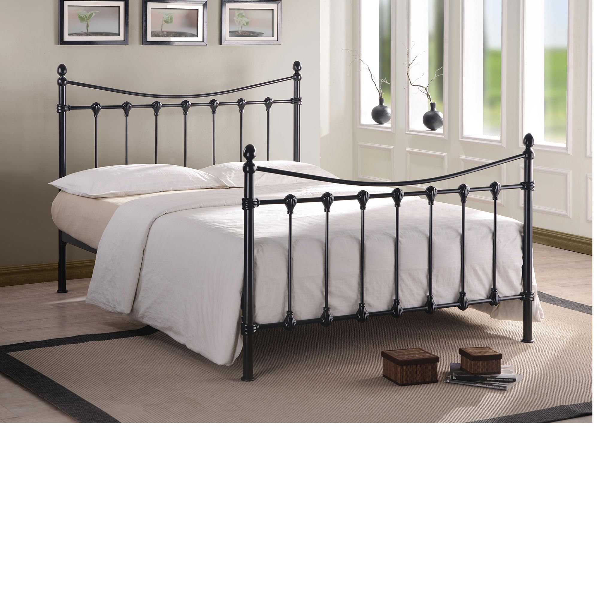 Black Metal Queen Bed Frame with white bedding and grey