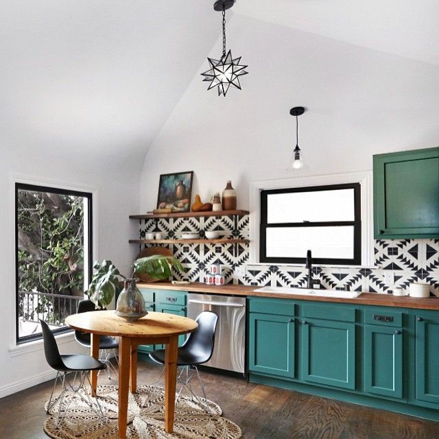 Black and white kitchen back splash, open shelves, teal kitchen cabinets, eclectic kitchen. #kitchendesigninspiration