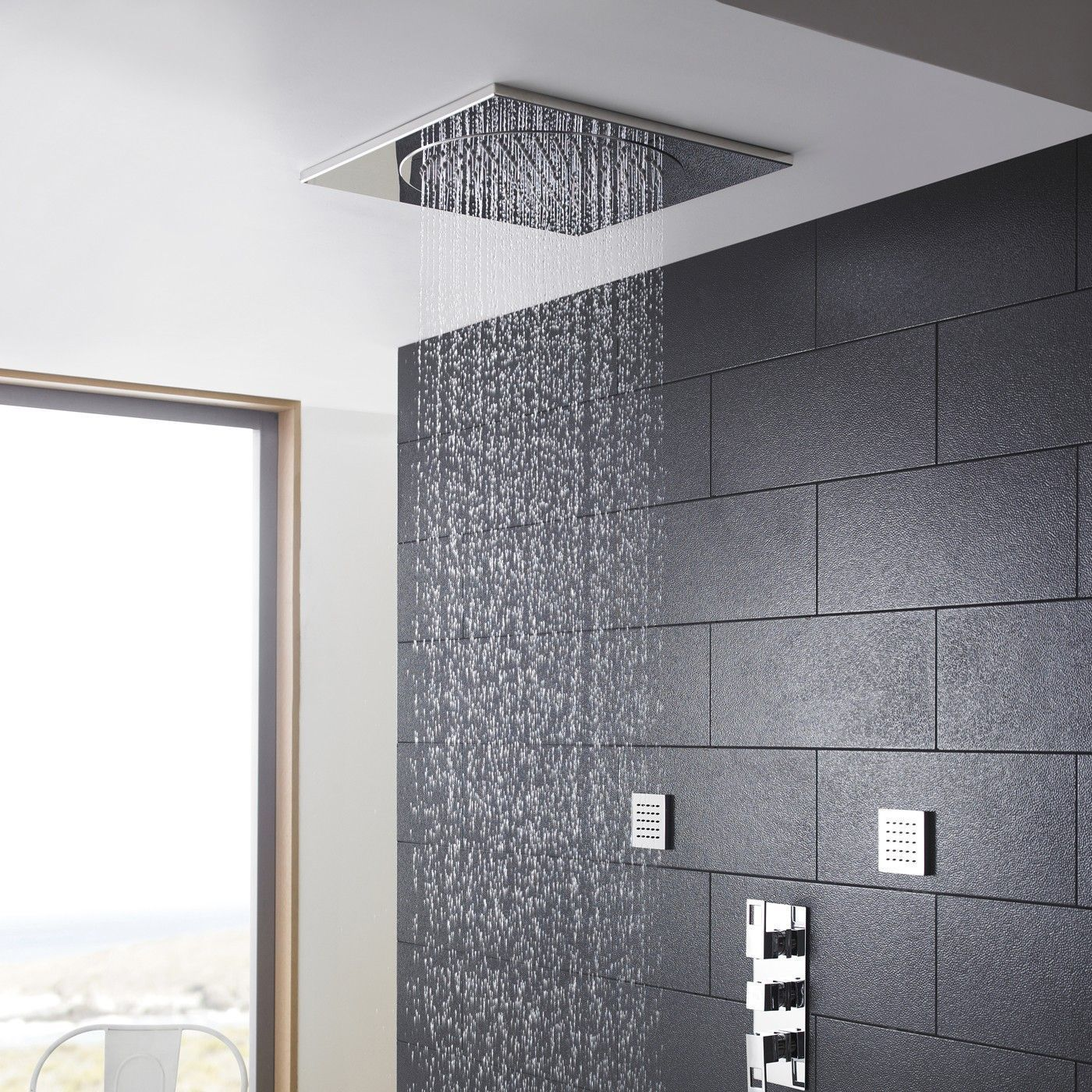 Enjoy a spa-like showering experience with this ceiling tile shower head